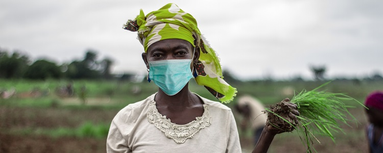 African Woman Farmer with mask