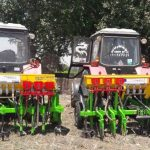 Two tractors with Raised Bed Machine attachments