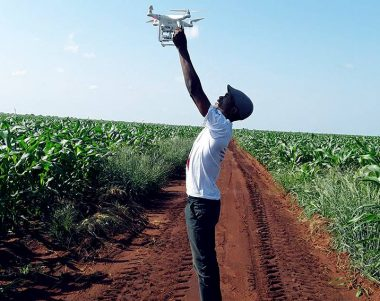 Farmer launching drone